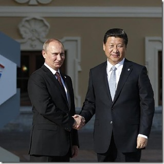 Vladimir Poetin (links) en Xi Jinping