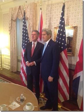 Phillip Hammond met John Kerry