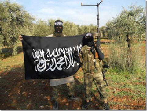 Bherlin Gildo - Zweeds lid al Nusra met vlag al Nusra